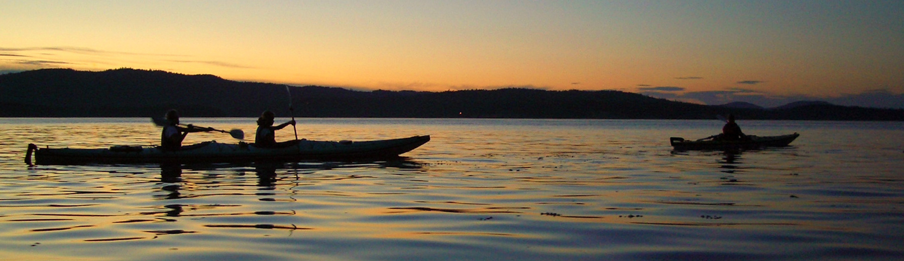 Kayakers in the sunset, Salt Spring Island, BC